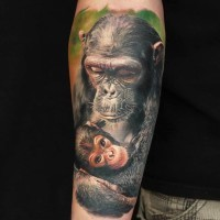 Tender color-ink mother and baby chimpanzee tattoo on arm