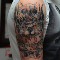 Trash skull and wolf tattoo on shoulder