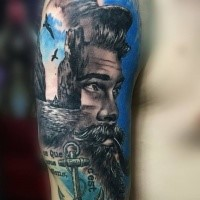 New school style colored shoulder tattoo of sailor face with anchor and birds