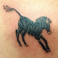 Unusual black-ink full size zebra tattoo