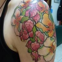 Unusual colorful flower tattoo for men on shoulder