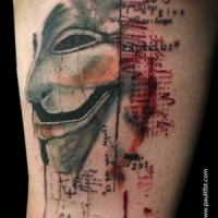 Usual colored thigh tattoo of Anonimous mask with lettering