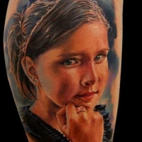 Very realistic painted colored portrait tattoo of young girl