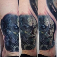 Very realistic pinted colored leg tattoo of creepy monster
