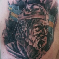 Viking head and a flag tattoo on shoulder