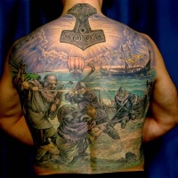 Viking warriors battle on the see tattoo on back