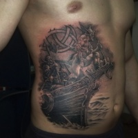 Viking warriors on ship tattoo on belly