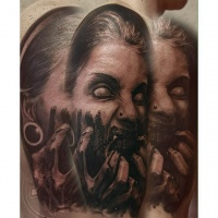 Vintage style detailed upper arm tattoo of demonic woman portrait with white eyes