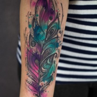 Watercolor feather tattoo on arm