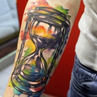 Watercolor hourglass forearm tattoo