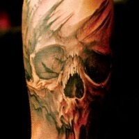 Watercolor skull tattoo on arm