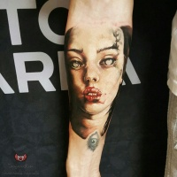 White eyed girl tattoo on forearm