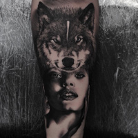 Wolf and woman tottoo on forearm