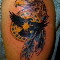 Wonderful colorful eagle head and feathers tattoo on shoulder