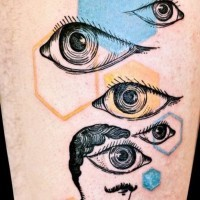 Abstract mystical style painted big eyes with geometric figures tattoo on upper arm