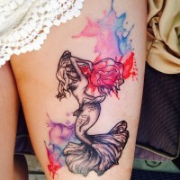 Abstract style black and white mermaid tattoo on thigh