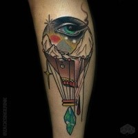 Abstract style colored forearm tattoo of big balloon with human eye