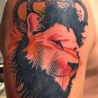 Abstract style colored shoulder tattoo of lion portrait with big crown