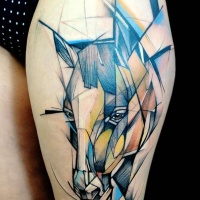 Abstract style colored thigh tattoo of sad horse