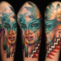 Abstract style multicolored shoulder tattoo of Indian woman with feather