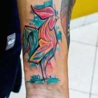 Abstract style painted colorful cock tattoo on wrist