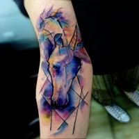Abstract style watercolor like little forearm tattoo of unicorn head