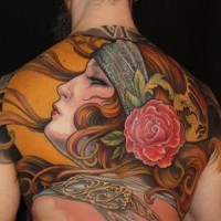 Accurate designed and colored beautiful woman tattoo on whole back stylized with red rose flower