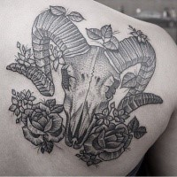 Accurate dot style scapular tattoo of animal skull and flowers