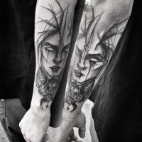 Accurate fantasy style painted by Inez Janiak arm tattoo of demonic woman with bug