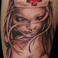 Accurate looking colored shoulder tattoo of sexy nurse portrait