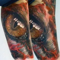 Accurate painted and colored mystic dragon eye tattoo on arm