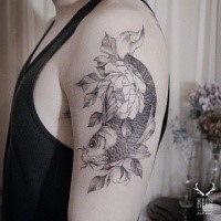 Accurate painted blackwork style shoulder tattoo of fish with flowers by Zihwa