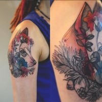 Accurate painted multicolored wolf tattoo by Joanna Swirska on upper arm