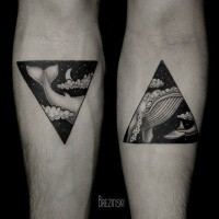 Adorable black triangle style whale forearm tattoo
