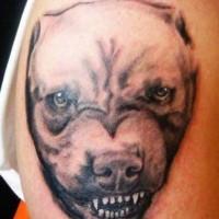 Tatuaggio sul deltoide il cane con la bocca spalancata