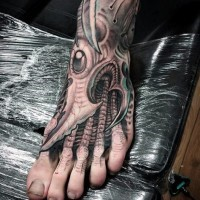 Alien style black and white biomechanical tattoo on foot