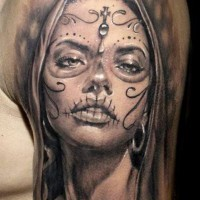 Alluring gray ink santa muerte girl with cross on forehead tattoo on shoulder