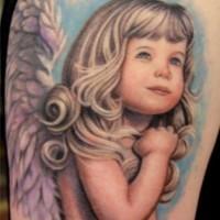 eccezionale colore ragazza bionda cherubino tatuaggio