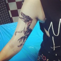 Amazing dinosaur tattoo