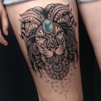 Amazing Asian style thigh tattoo of lion head with jewelry
