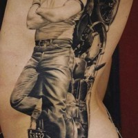 Amazing biker with motorcycle tattoo on ribs