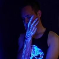 Amazing black hand skeleton light tattoo