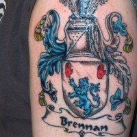 Amazing brennan family crest tattoo on half sleeve