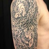 Amazing celtic knot animals tattoo on shoulder