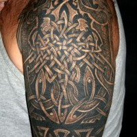 Amazing celtic knot tattoo on shoulder