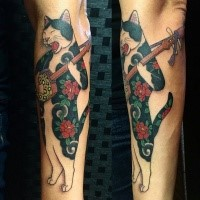 Amazing colored by horitomo forearm tattoo of Manmon cat musician
