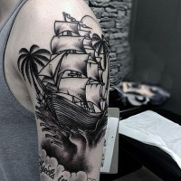 Amazing detailed ship and palm trees nice tattoo on arm