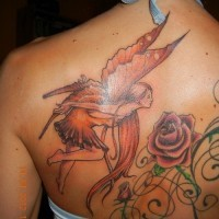 Amazing fairy with red hair tattoo on back