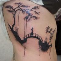 Amazing landscape with suspension bridge tattoo on ribs