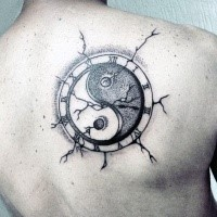 Amazing looking black ink dot style old clock tattoo stylized with Yin Yang symbol
